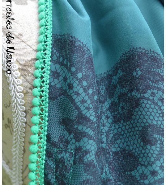 Foulard à pompons vert et noir