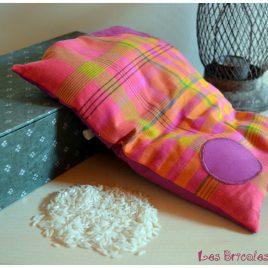 Bouillotte ventrale rose violette et orangée à rayures