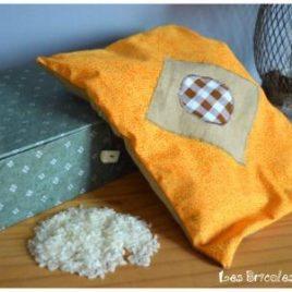 Bouillotte ventrale orange à petites fleurs